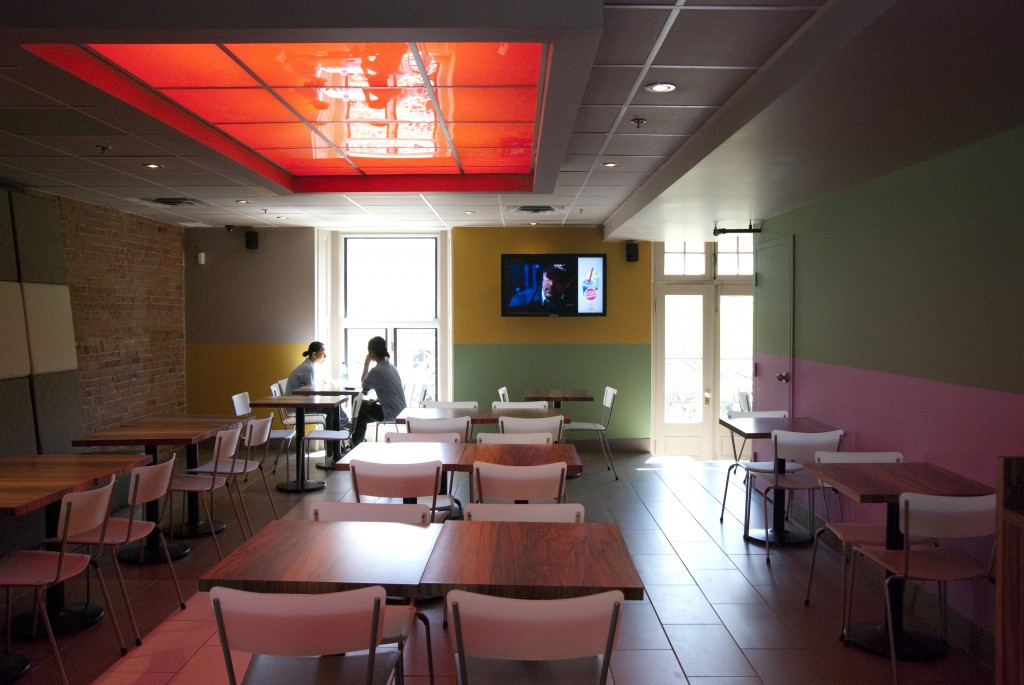 Vua dining area, digital screen combining TV and ads