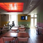 Vua dining area, digital screen combining TV and ads